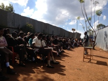 Outdoor preaching to school children during a school day.